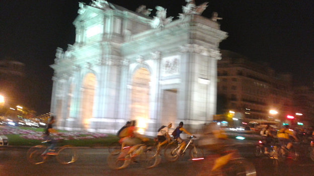 Cyclists whiz past Madrid's Puerta de Alcalá monument as part of Bici Crítica, a movement that seeks to raise awareness of bike safety. On the last Thursday of every month, thousands of cyclists ride in unison through downtown Madrid, blocking traffic during rush hour.