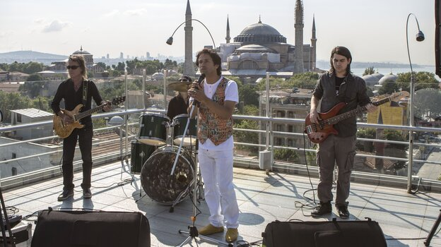 Ahmet Muhsin Tuzer, in white, is lead singer for FiRock, which combines Sufi mysticism and psychedelic rock.