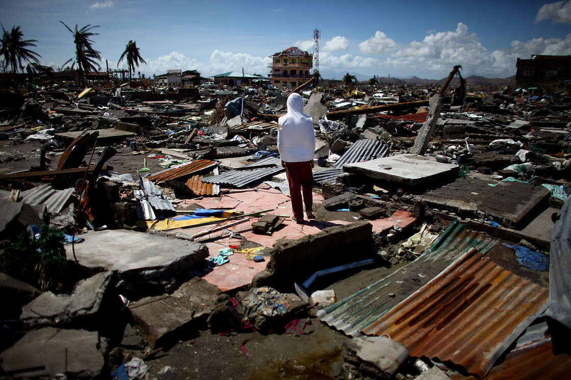 A boy stands amid the ruins of the San Jose neighborhood of Tacloban, in the central Philippines, on Friday. Food and water supplies are almost nonexistent, as little or no aid has reached people in the city or surrounding neighborhoods. Tacloban was destroyed after Typhoon Haiyan tore through the region, leaving thousands of people dead and even more missing or injured.