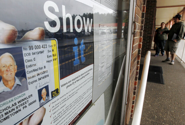 Before the voter ID law was put on hold, this Penndot Drivers License Center in Butler, Pa., displayed signs promoting the requirement for voters to show an acceptable photo ID at the polls.