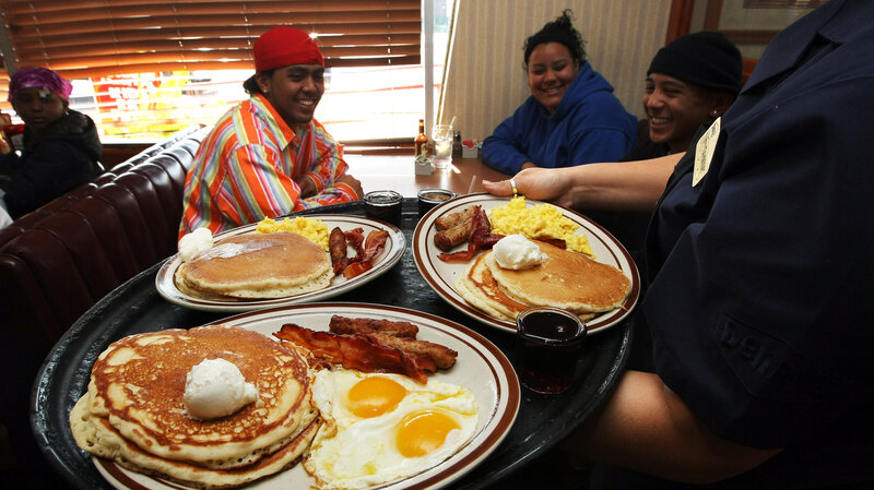 A Denny's waitress delivers breakfast to customers in Emeryville, Calif. The tipped minimum wage has been stuck at $2.13 since 1991.