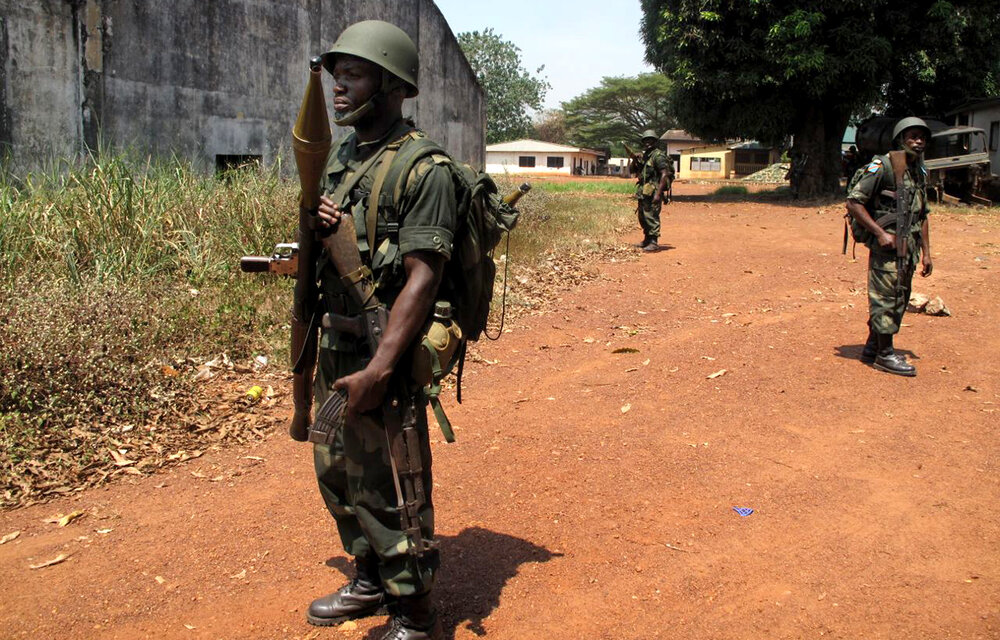 Central African Republic government soldiers stand just outside the city center of Bangui, the country's capital. Christian militias have been attacking Muslims in the capital and elswhere, leading entire Muslim communities to flee.