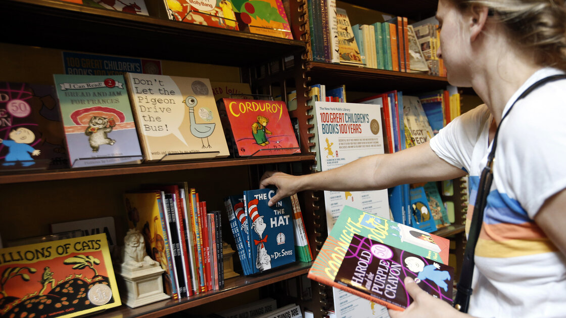 Anne Sophie Parigot searches for books for her 3- and 6-year-old children at the New York Public Library bookstore in 2013.