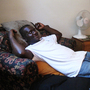 Mallyveen Teah relaxes in his Arlington, Va., apartment after work.