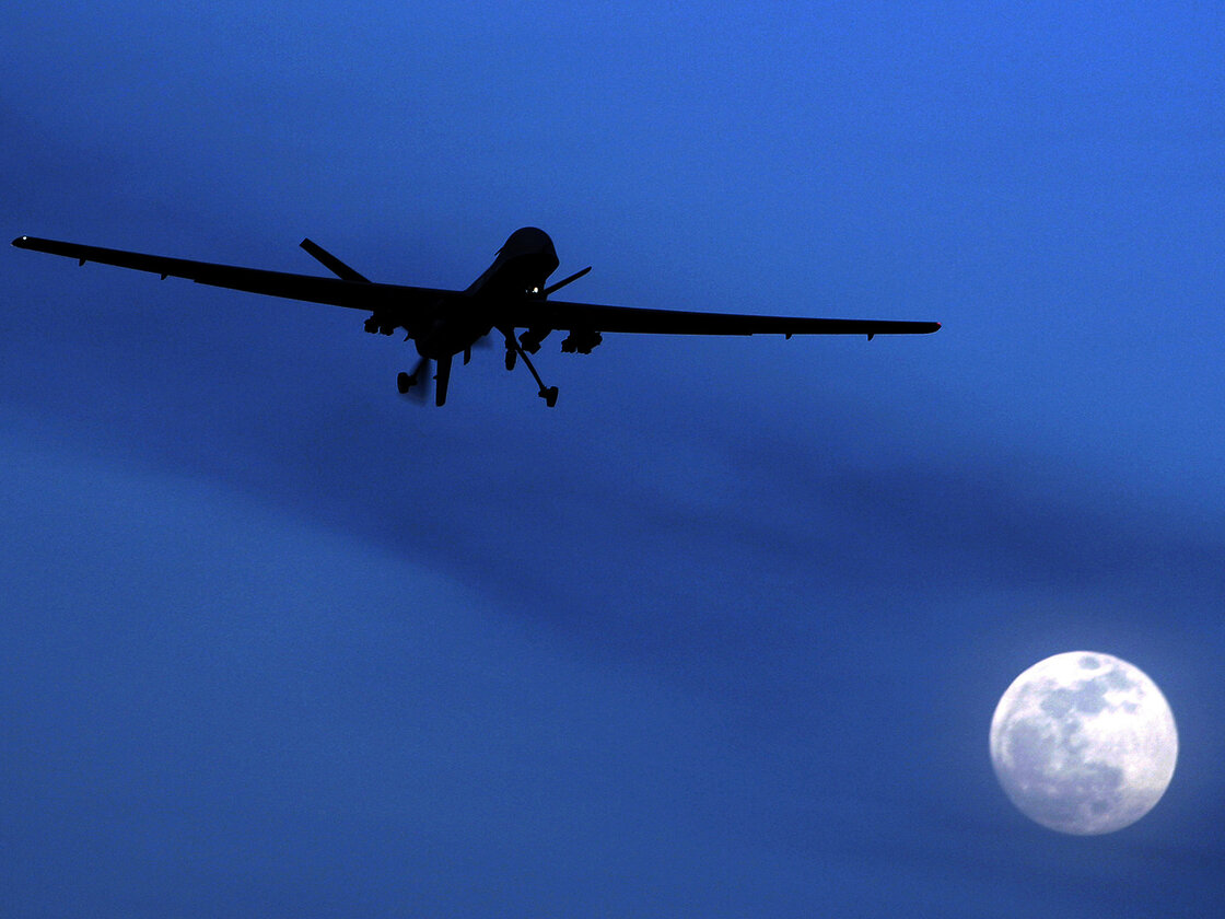 An unmanned U.S. Predator drone flies over Kandahar Air Field, southern Afghanistan, in 2010. A new report questions the U.S. policy of using armed drones abroad to carry out attacks on suspected terrorists.