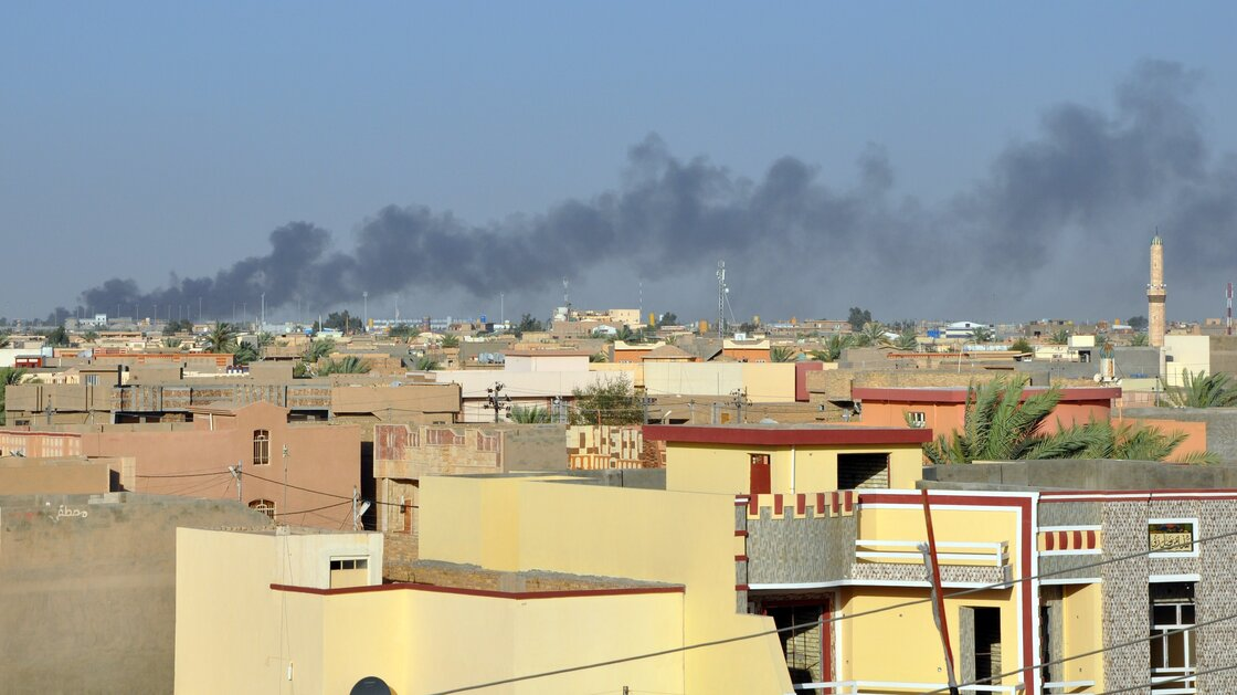 Smoke rises from buildings in May after shelling on the Iraqi city of Fallujah, which is currently held by anti-government fighters.