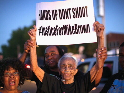 Demonstrators protest the killing of teenager Michael Brown by Police.