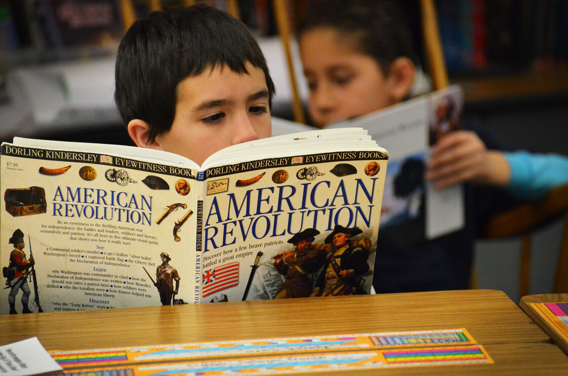 Fourth-grader Isiah Soto digests some history during independent reading time.