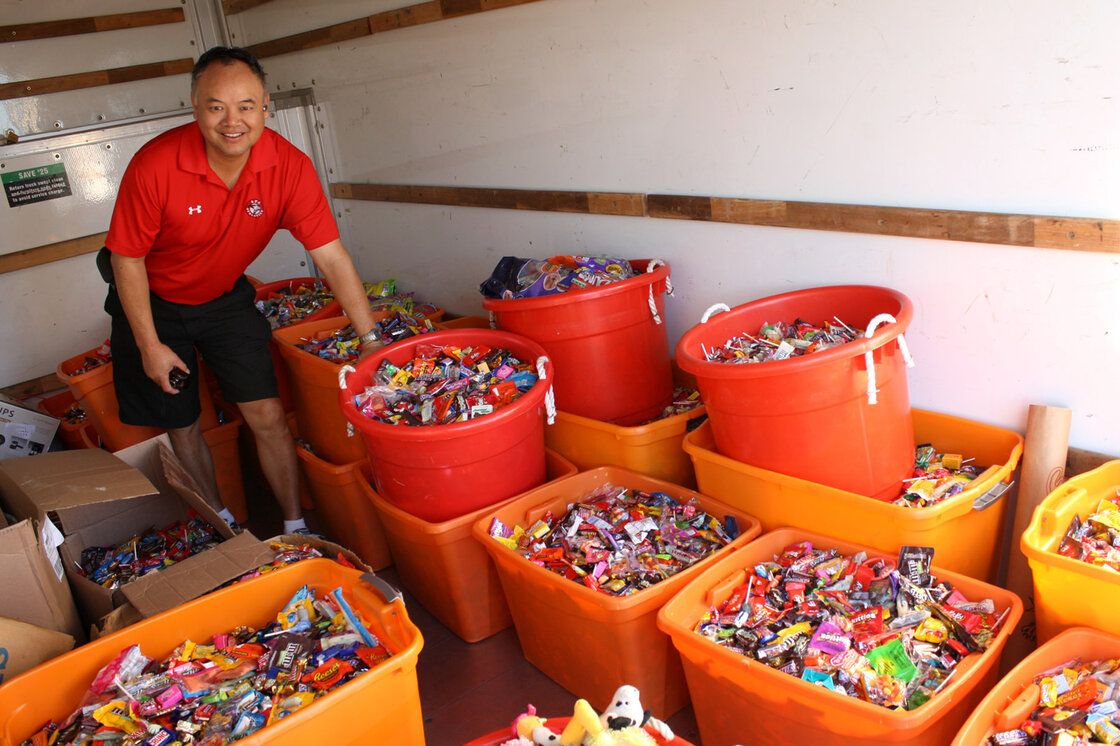 Dr. Curtis Chan, a dentist in Del Mar, Calif., loads up a truck with 5,456 pounds of candy to deliver to Operation Gratitude during the Halloween Candy Buy Back on Nov. 8, 2013. Dr. Chan personally collected 3,542 pounds of candy from patients.