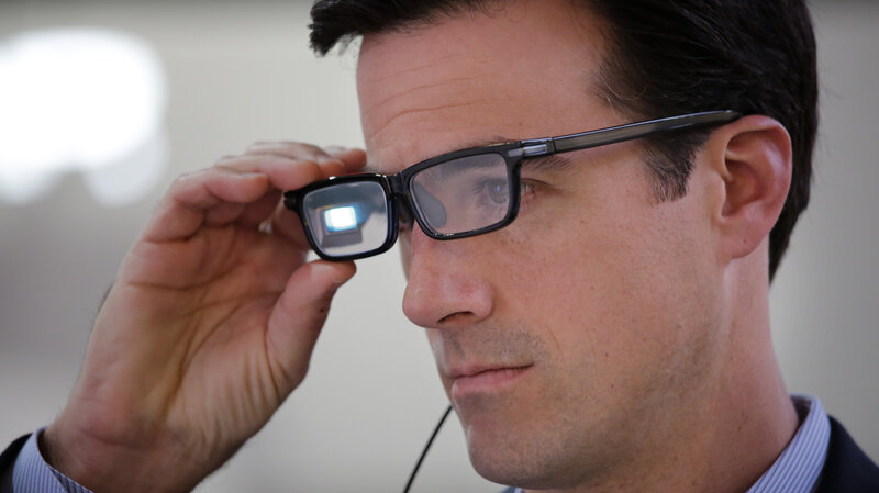 Chris Barnes tries out Toshiba Glass, one of a number of new wearable gadgets at the 2015 Consumer Electronics Show in Las Vegas.