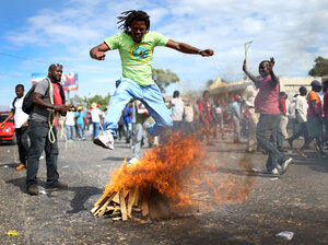 Haitians protested in the streets of Port-au-Prince on Sunday, calling for the resignation of President Michel Martelly.