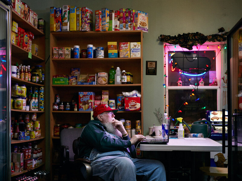 "Gary Carr works at the Kozy Korner grocery store. ""He spends a lot of time on that computer,"" photographer Reed Young says. ""One of his obsessions was keeping up with Top 40 radio."""