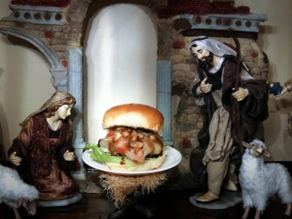 "The ""Cheeses Is Born Burger,"" displayed on Bowden's mother's Nativity scene. ""My mom was not too thrilled with me taking baby Jesus out of the scene and putting a burger in its place,"" says Bowden."
