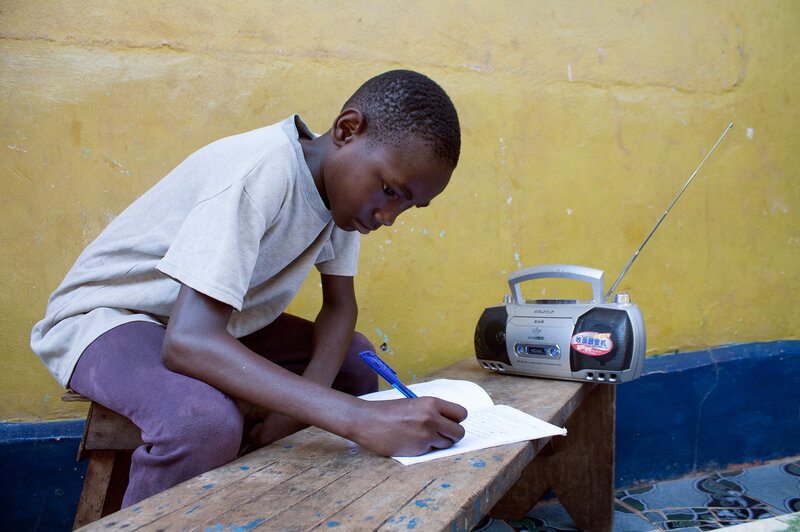 Jimmy Kamara, 9, is one of the students in Sierra Leone who use radios to continue their education while schools remain closed owing to Ebola.