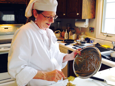 Chef Sina Sundby cooks delicious, nutritious meals in Jim Schulz's home in a suburb of Madison, Wis.
