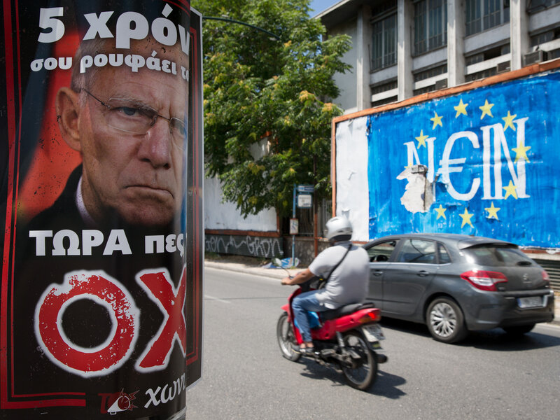 "German Finance Minister Wolfang Schaeuble is depicted on a pro No poster (left) next to a graffiti (right) that read ""No"" (Nein) in German but also sounds like ""Yes"" in Greek. The photo was taken in Athens, on Sunday."
