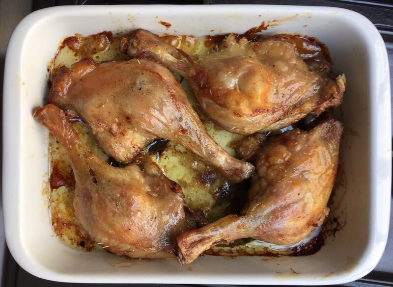 browned duck legs in baking dish