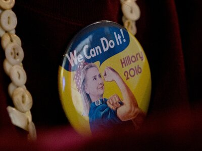 A woman wears a campaign button in the vein of Rosie the Riveter to a Hillary Clinton event in Davenport, Iowa.