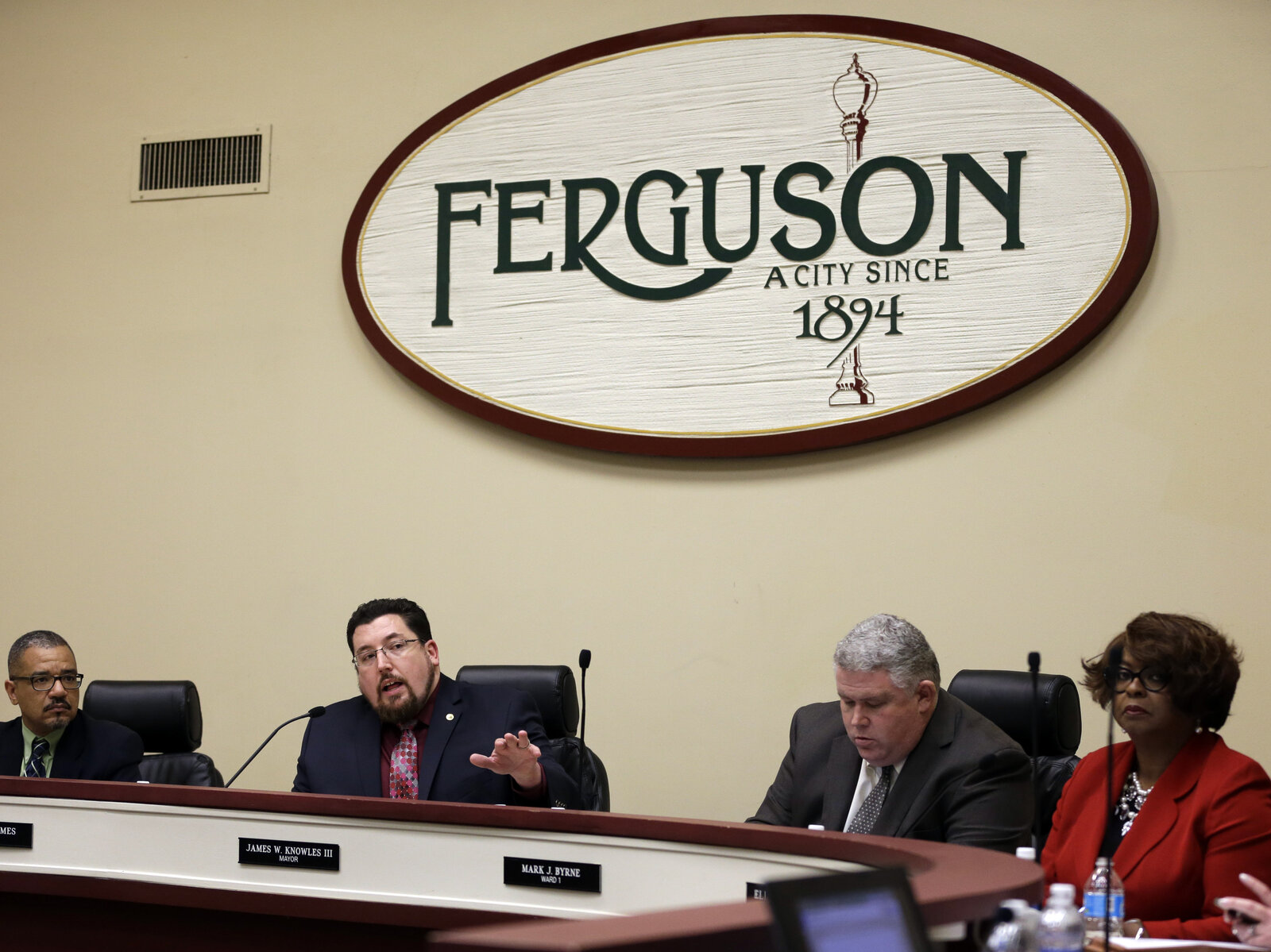 Ferguson mayor James Knowles III, (second from left) speaks during a city council meeting on Feb. 2. The meeting was the first opportunity for residents to speak directly with city leaders about the preliminary consent agreement with the U.S. Department of Justice.