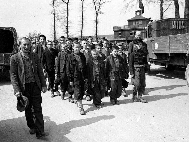 Children and other prisoners liberated by the U.S. Army march from Buchenwald concentration camp in April 1945. The tall youth in the line at left, fourth from the front, is Elie Wiesel.