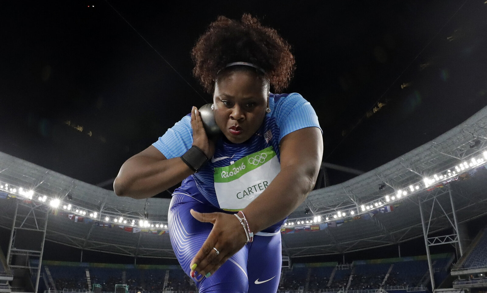 Michelle Carter competes in the women's shot put final during the 2016 Summer Olympics at the Olympic stadium in Rio de Janeiro, Brazil, on Friday.