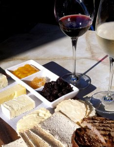 Red and white wine in glasses with  cheese platter of variety cheeses also may be better choice than the salt npr rh