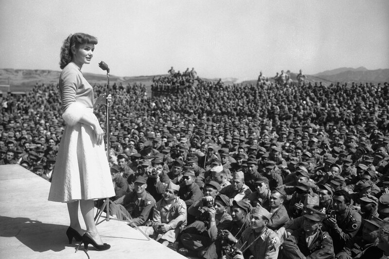 Debbie Reynolds entertains soldiers at the 8th Army headquarters in Seoul, South Korea in May 1955.