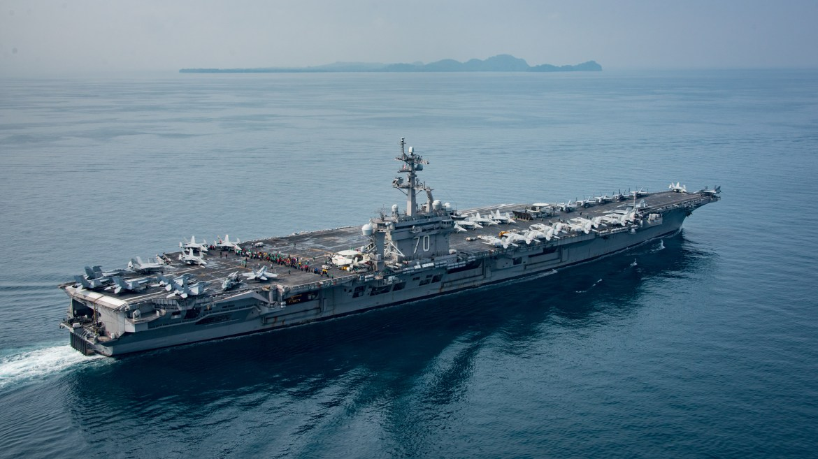 An official photograph dated April 15 and posted by the Navy shows the aircraft carrier USS Carl Vinson in an Indonesian strait thousands of miles south of North Korea.