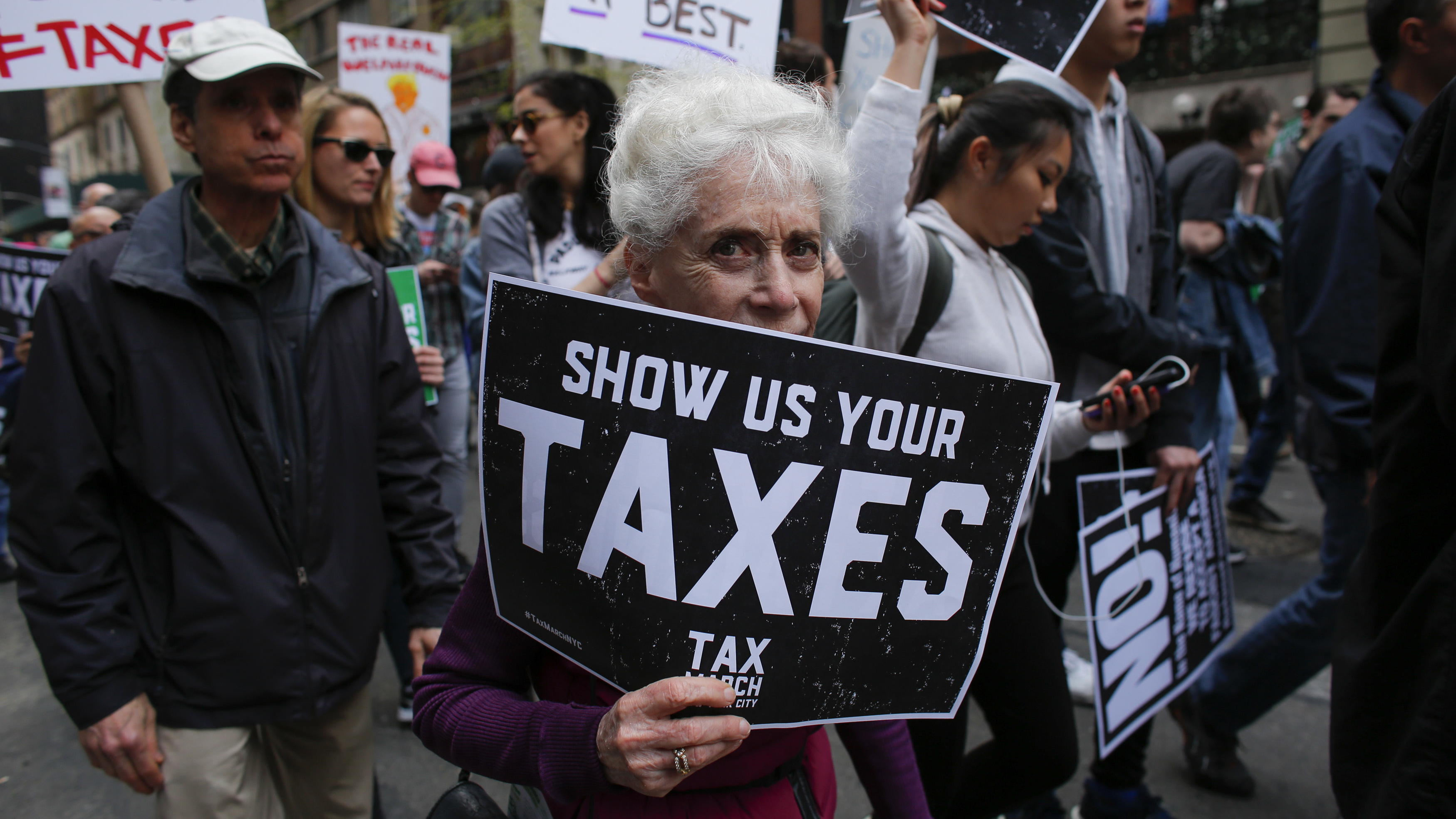 Protesters take part in the Tax March in New York on April 15 calling on President Trump to release his tax returns.