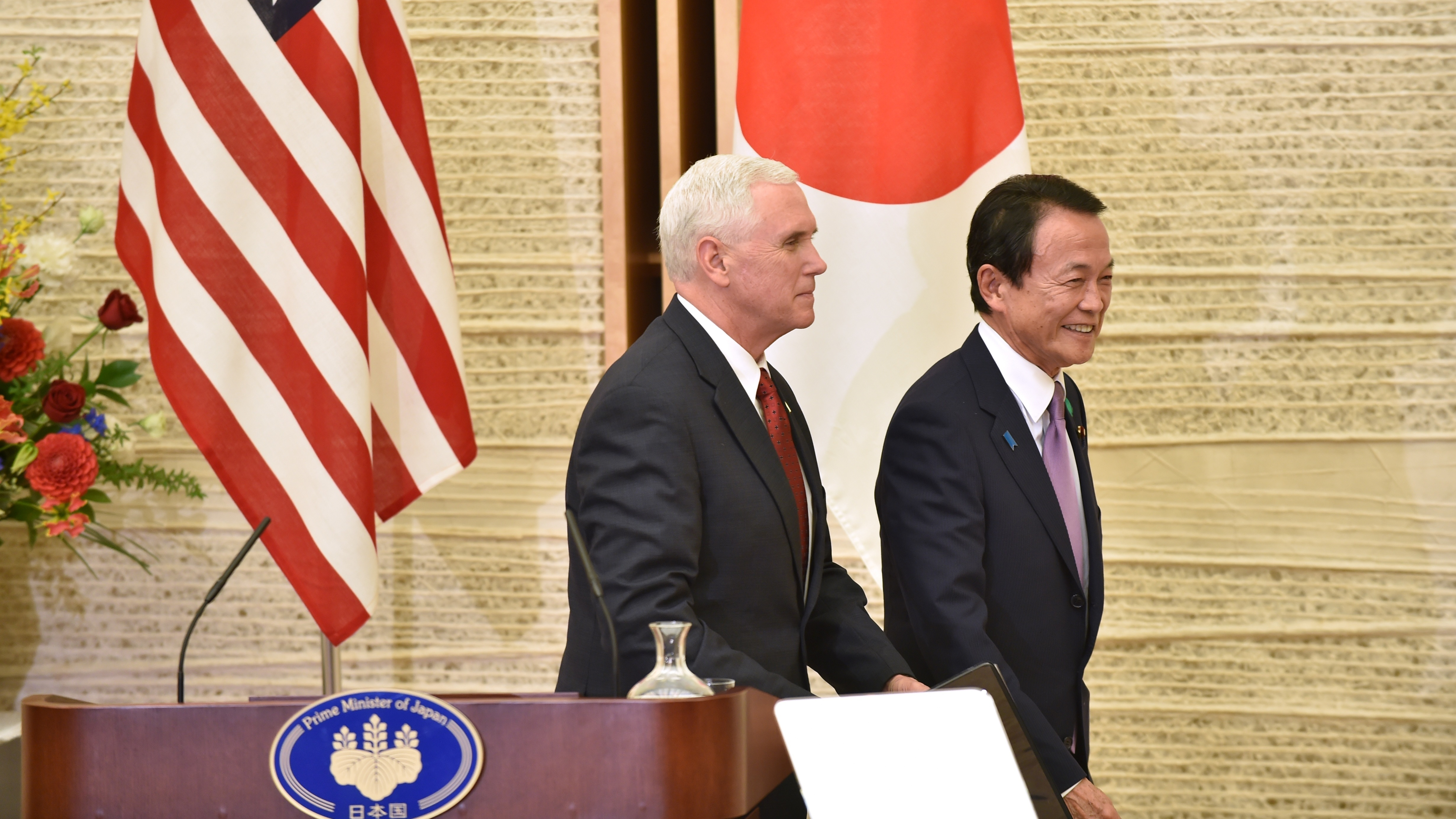 Vice President Pence and Japanese Deputy Prime Minister and Minister of Finance Taro Aso leave the prime minister