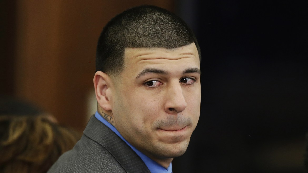 Former New England Patriots tight end Aaron Hernandez looks toward the jury as he reacts to his double murder acquittal last week. Hernandez hanged himself and was pronounced dead at a Massachusetts hospital early Wednesday, according to officials.
