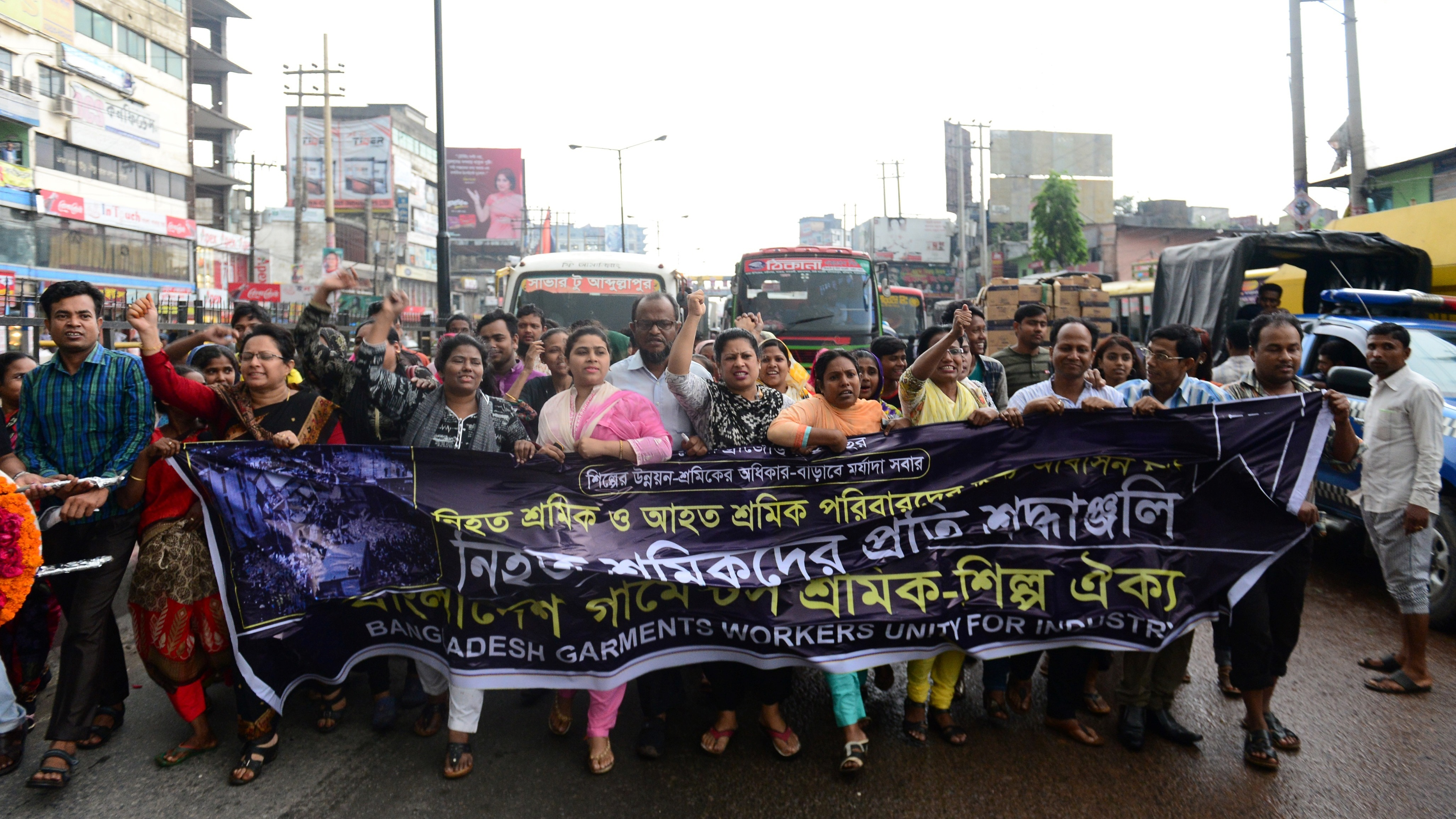 Bangladeshi activists mark the fourth anniversary of the Rana Plaza building collapse at the site where the building once stood in Savar, on the outskirts of Dhaka, on April 24.