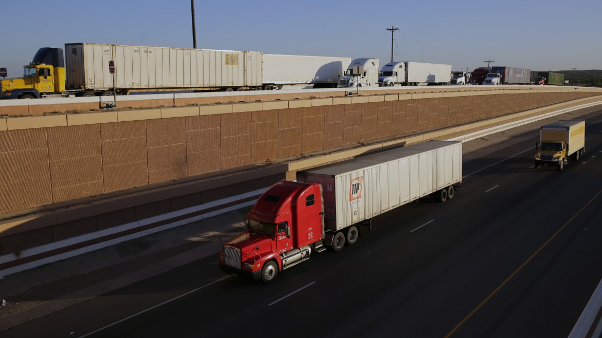 Trucks move along Interstate 35 in Laredo, Texas. It