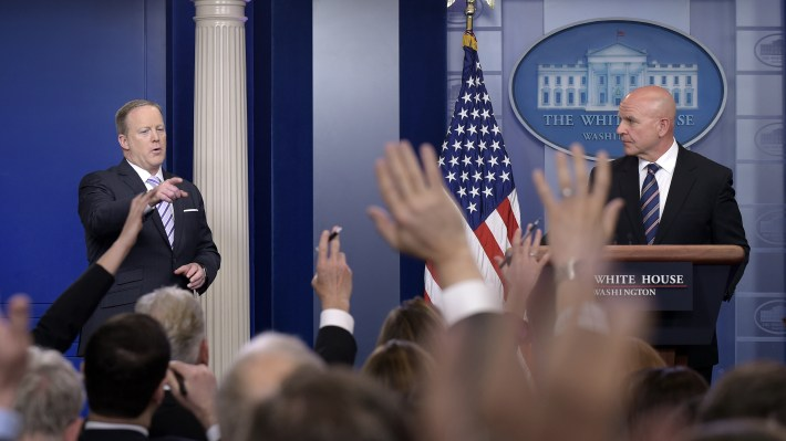 White House press secretary Sean Spicer, left, calls on a reporter as national security adviser H.R. McMaster listens at right during a briefing at the White House Tuesday.