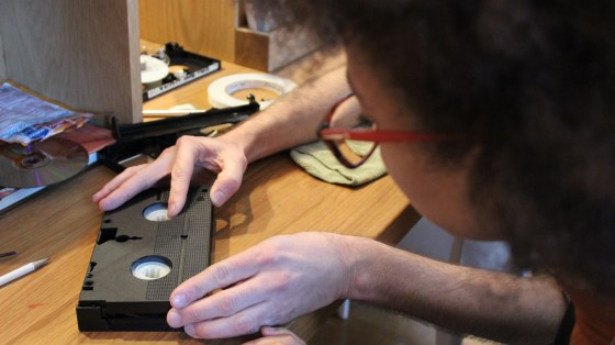 XFR Collective member Carmel Curtis works on a VHS cartridge during an event at the Baltimore Museum of Art in March.