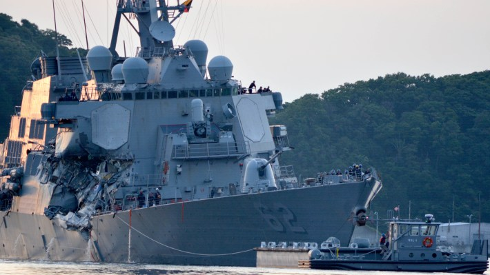 The Arleigh Burke-class guided-missile destroyer USS Fitzgerald (DDG 62) returns to Fleet Activities (FLEACT) Yokosuka following a collision with a merchant vessel while operating southwest of Yokosuka, Japan.