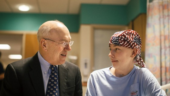 Dr. Kurt Newman visits with 14-year-old Jack Pessaud, who