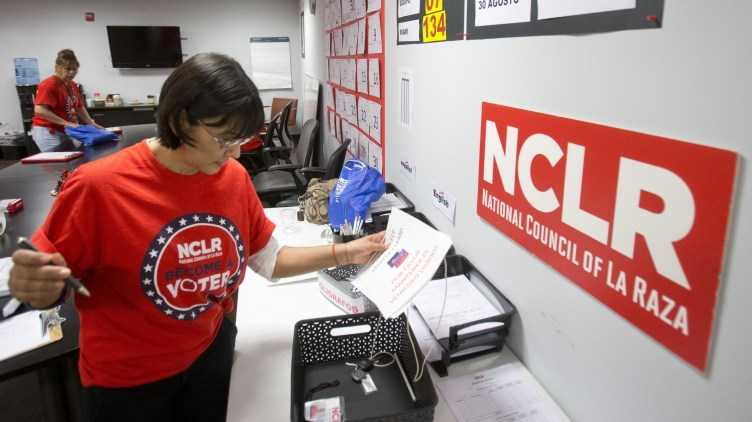 Canvasser Ana Mejia gathers her supplies at the offices of the National Council of La Raza (NCLR) in Miami in 2016. The NCLR renamed themselves this month, causing a rift in the U.S. Latino community. Some see it as shedding a dated name, while others see it as leaving a legacy behind.