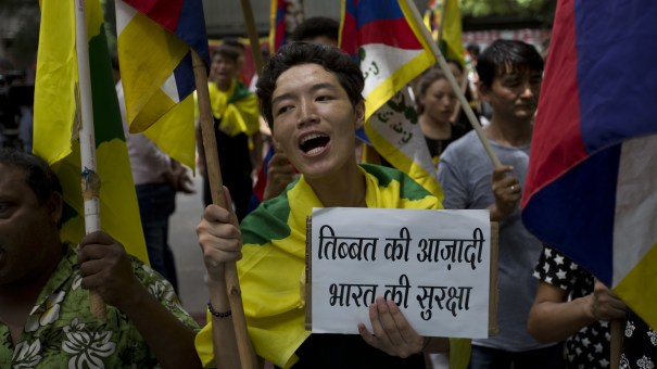 Exiled Tibetans shout slogans during a protest to show support for India on the Doklam standoff in New Delhi, India, on Friday.
