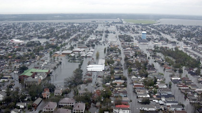 (Left) Flooded neigborhoods can be seen in New Orleans in 2005. (Right) Flooded homes are shown near Lake Houston following Hurricane Harvey on Aug. 30.