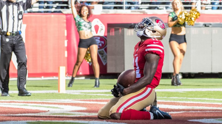 San Francisco 49ers wide receiver Marquise Goodwin fell to his knees in the end zone after scoring a touchdown against the New York Giants Sunday. He later revealed that he and his wife had endured a personal tragedy.