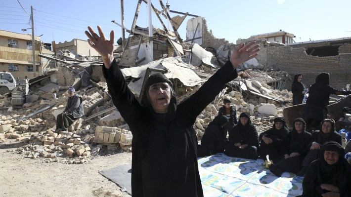 A woman mourns at an earthquake site in Sarpol-e Zahab in western Iran, on Tuesday.