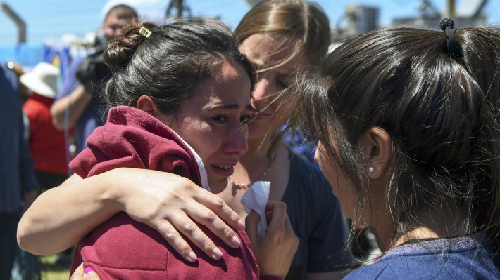 A relative of one of the 44 crew members of the missing Argentine submarine is comforted outside a navy base in Mar del Plata, Argentina, Thursday.