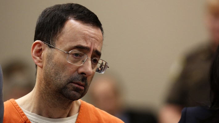 Former USA Gymnastics doctor Larry Nassar was sentenced on Thursday for possession of child pornography. Nassar is pictured here in court in Lansing, Mich., last month.