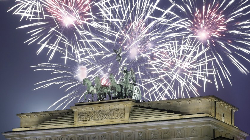 Fireworks light the sky above the Quadriga at the Brandenburg Gate shortly after midnight in Berlin, Germany, Sunday, Jan. 1, 2017.
