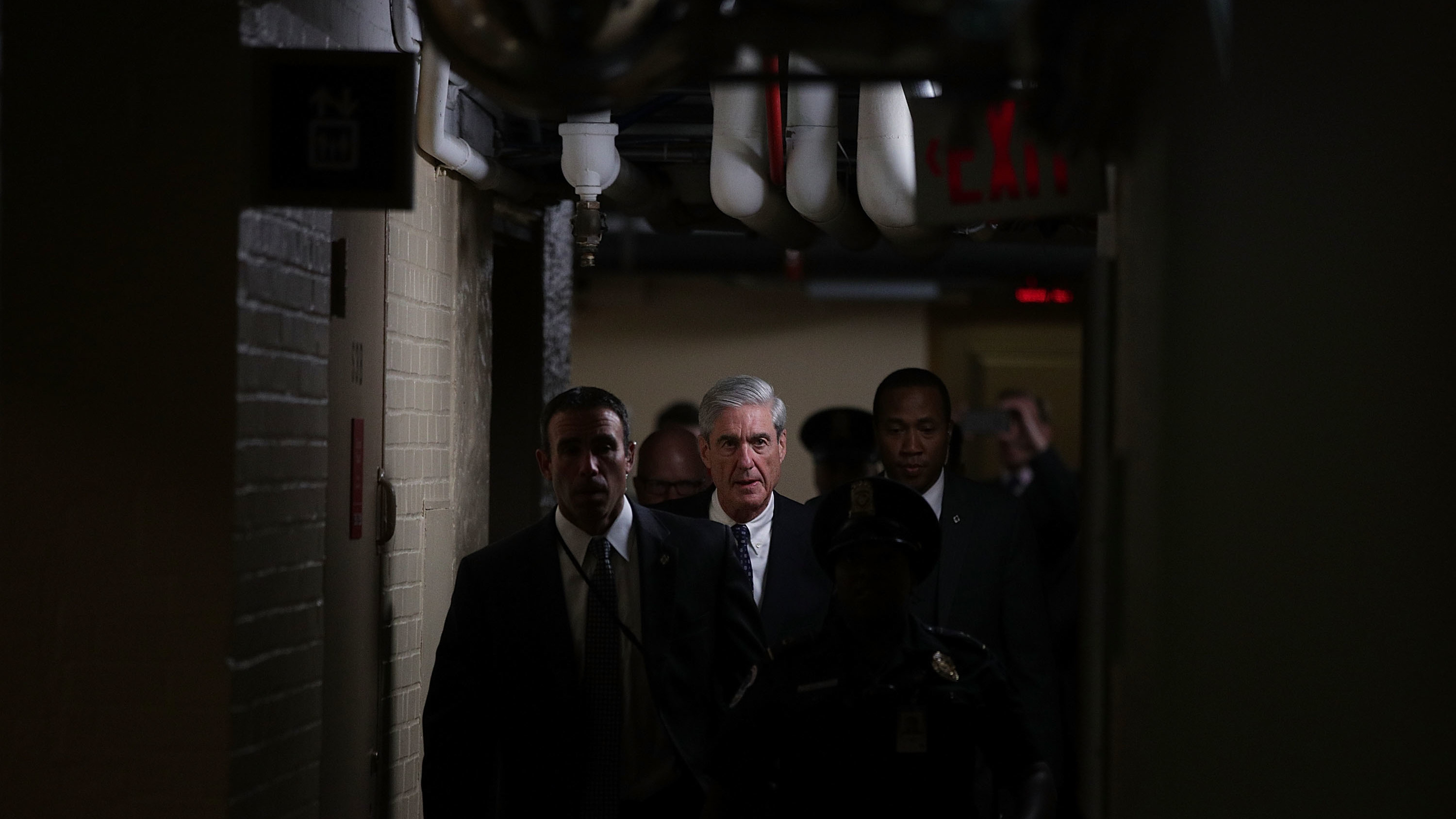 Special counsel Robert Mueller (center) leaves after a closed meeting with members of the Senate Judiciary Committee on June 21, 2017, at the Capitol in Washington, D.C.