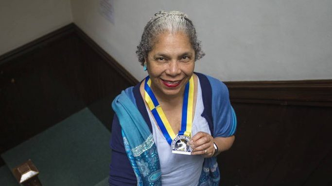 """""""If my life were to end next week ... I want to feel like I have made a contribution,"""" said Carol Martin, seen here holding her 2018 Boston Marathon medal."""