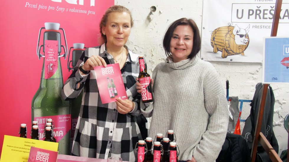 """Jana Kročáková and Petra Plánková of Mamma HELP show off their new brew aimed at helping breast cancer patients undergoing chemo """"feel normal"""" and overcome their impaired sense of taste."""