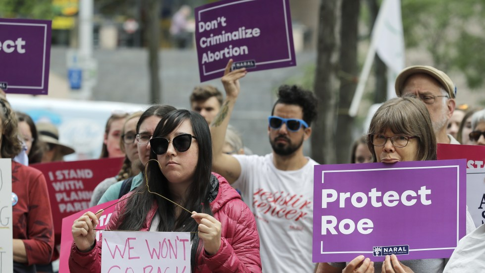 Abortion-rights supporters in Seattle protest on Tuesday against President Trump and his choice of federal appeals Judge Brett Kavanaugh as his second nominee to the Supreme Court. Activists are preparing for the possibility that Kavanaugh