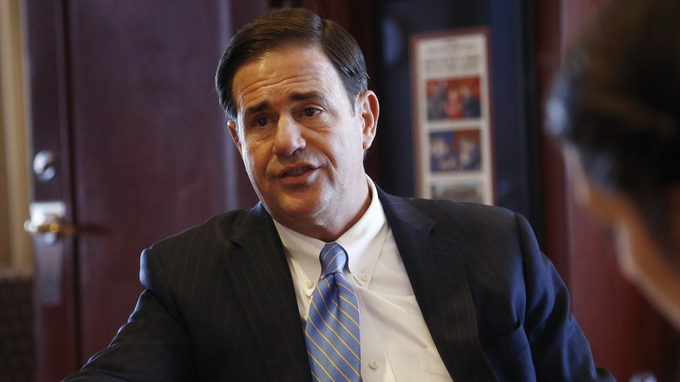 Republican Gov. Doug Ducey speaks about a variety of issues during an interview in his office at the Arizona Capitol in May 2018, in Phoenix.